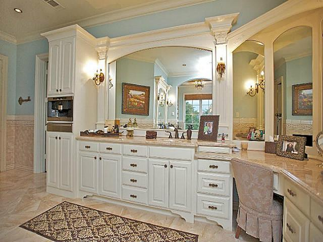 Spacious Master Bathroom With Alcove Tub And Corner Double Sink